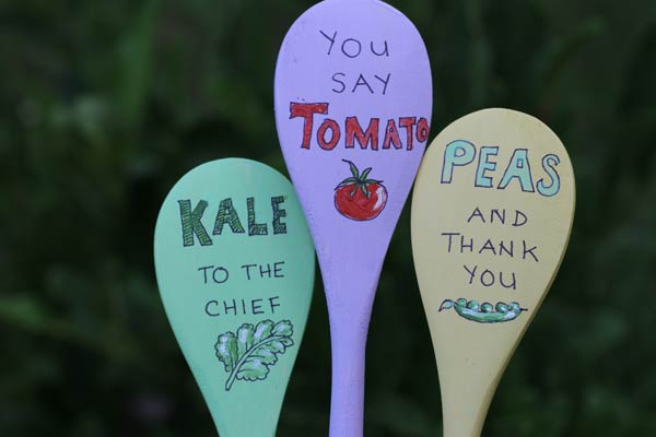 Use wooden spoons to create garden plant markers.
