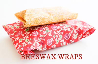 Beeswax wraps holding sandwiches and fruit.
