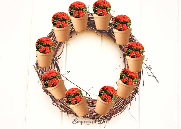 Attach tiny clay pots to a wreath for a super cute garden art creation