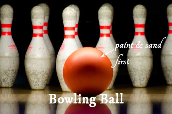 Bowling balls can be painted and sanded and used for making decorative garden art balls
