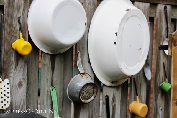 Kitchen supplies used as fence art.