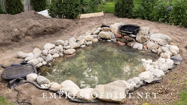 Waterfall box and skimmer added to garden pond construction.