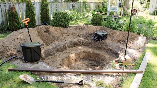 Excavating garden pond.