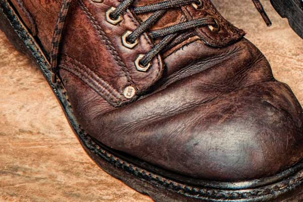 Boot polished with beeswax to form a water-resistant barrier.