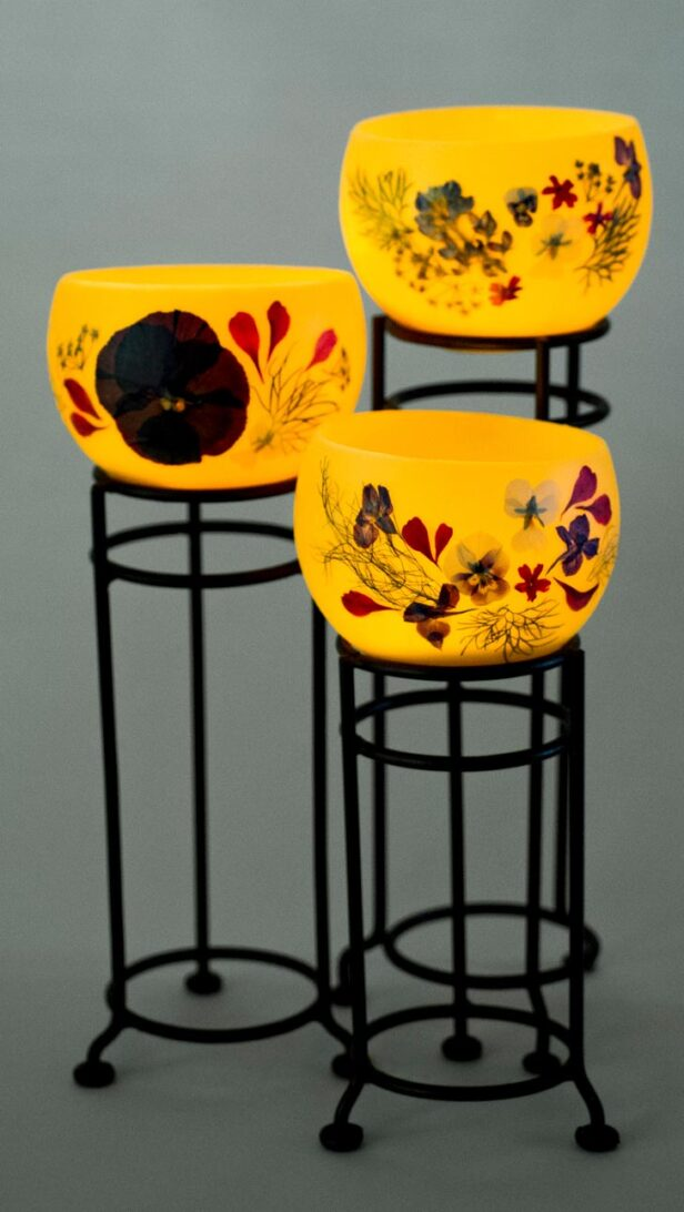 Luminary beeswax bowls with pressed flowers.