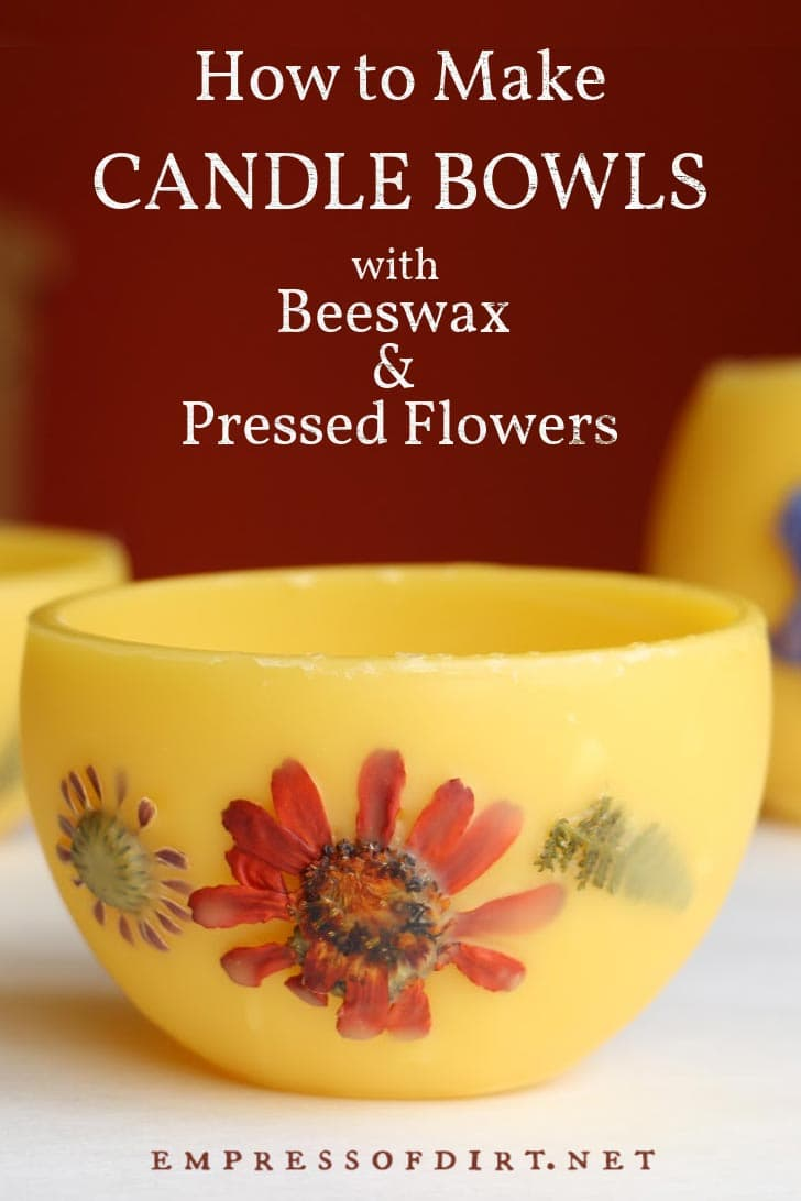 Homemade beeswax candle bowls with pressed flowers.