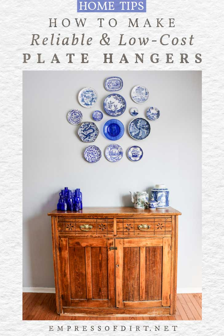 Collection of blue plates hanging on a wall using homemade plate hangers.
