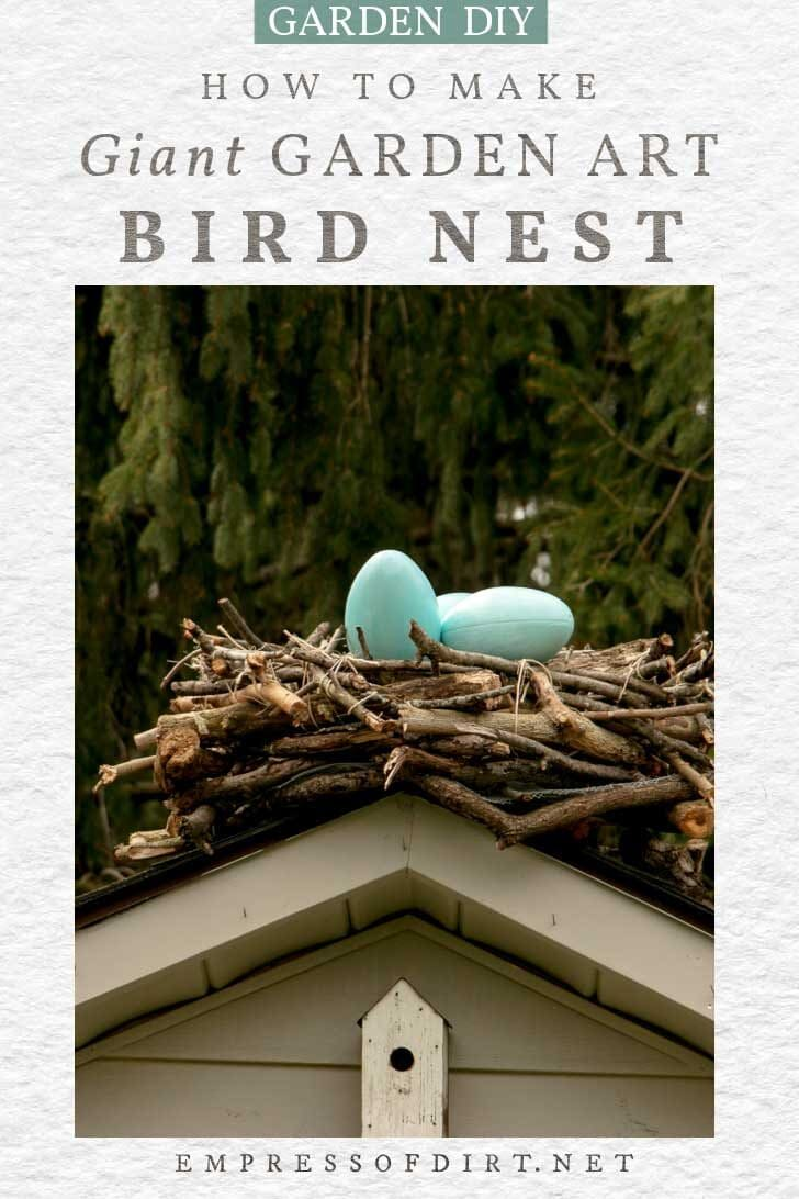 Giant decorative bird nest made from branches with blue eggs inside.