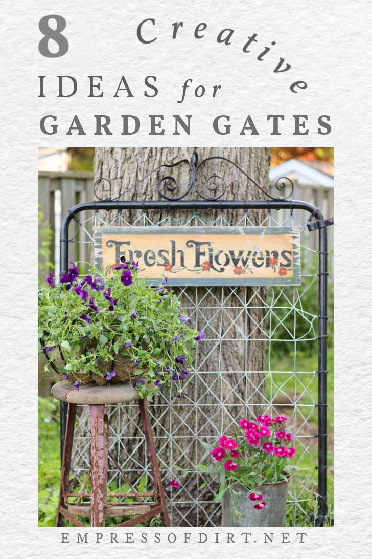 Old fashioned garden gate with flower pots and art.