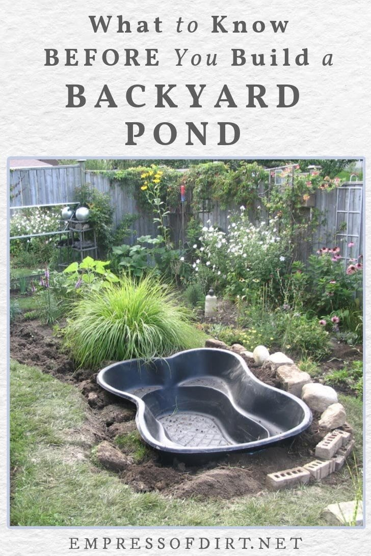 A pre-formed garden pond ready for installation in the yard.
