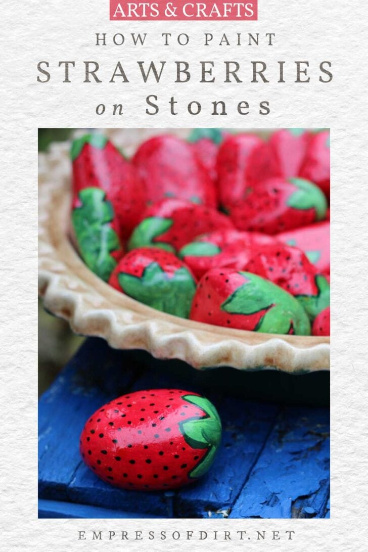 Stones hand-painted to look like strawberries.