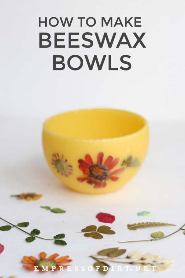 Bowl made from beeswax with pressed flowers.
