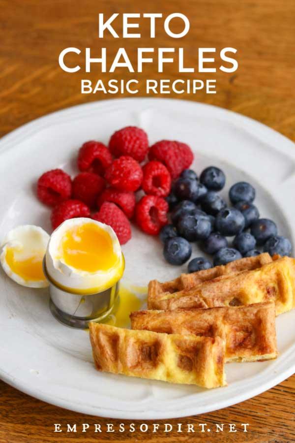 Keto waffles (chaffles), soft boiled egg, raspberries and blueberries.