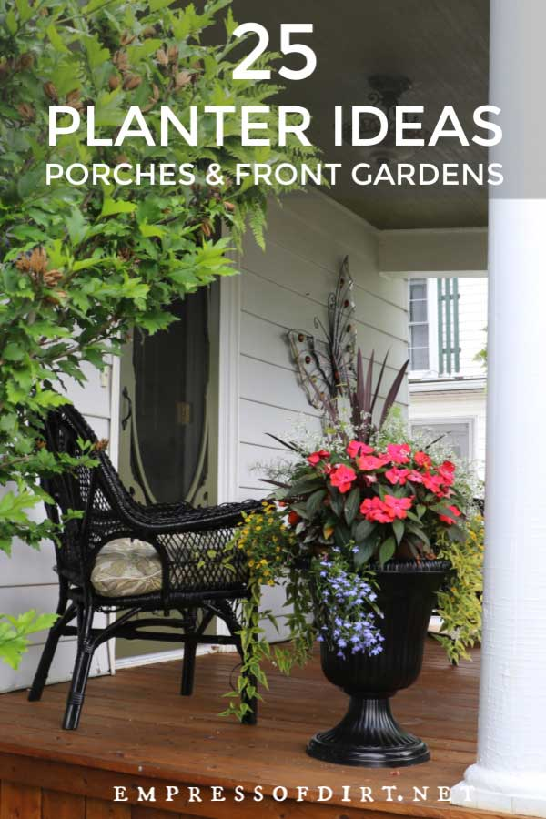 Front porch with black wicker chair and black urn filled with red flowers.