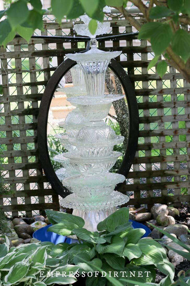 Crystal dishes made into a garden fountain.