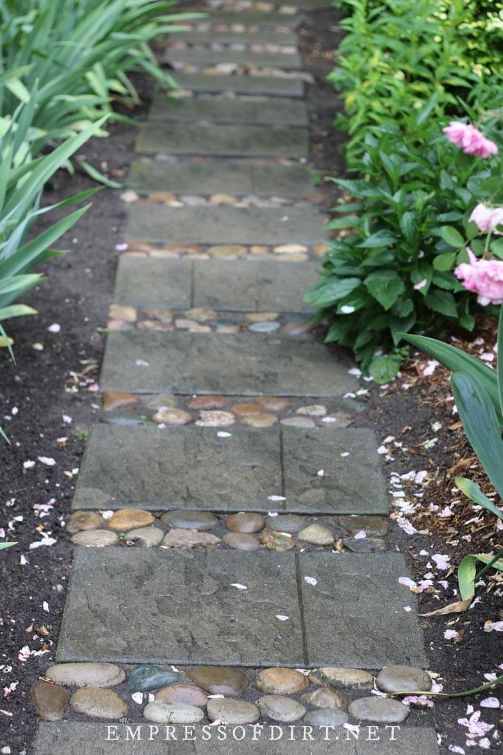 Pavers with inlaid stone.