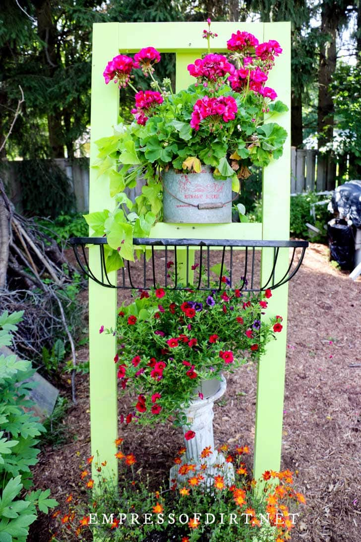Bright green garden easel with pink flowers.