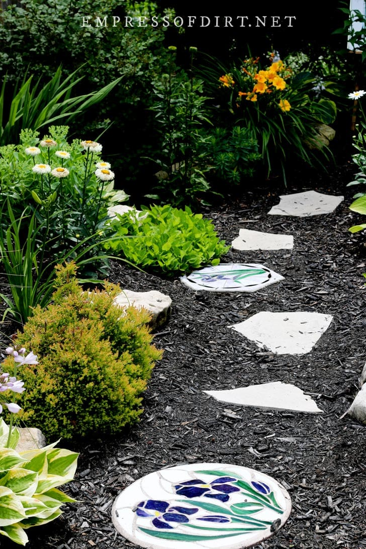 Mulched path with mosaic stone.