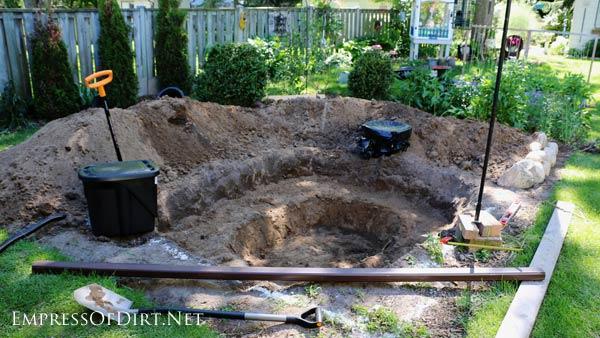 Digging a backyard garden pond.