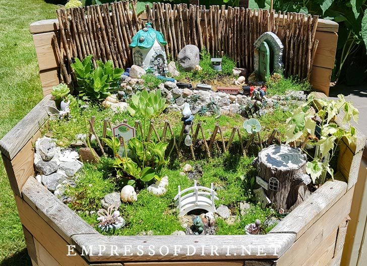 Fairy garden built in raised deck planter.