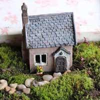 Fairy garden with miniature house.