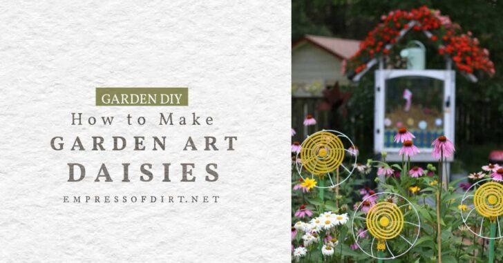 Decorative garden art daisies in a flower garden.