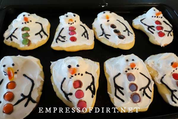 Melted snowman cookies on baking tray.