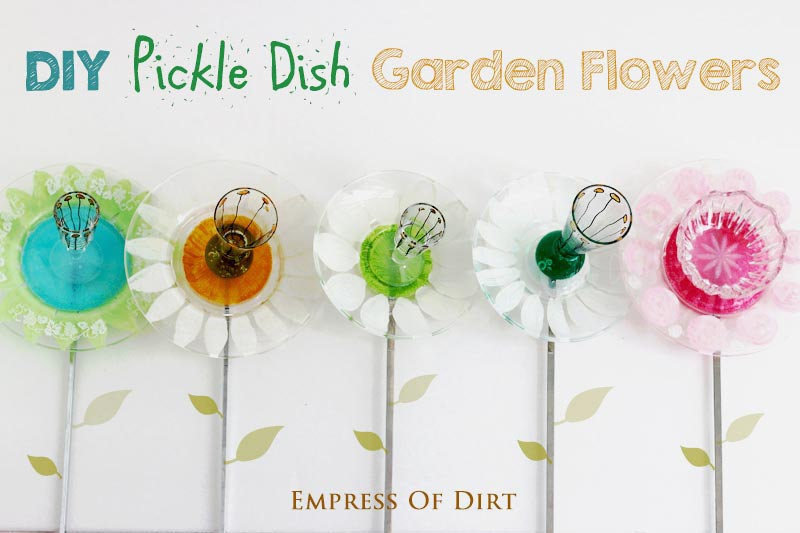 Garden art flowers made from pickle dishes and mini vases.