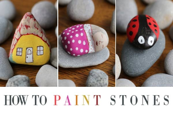 Handpainted stones including a house, lady sleeping, and ladybug.