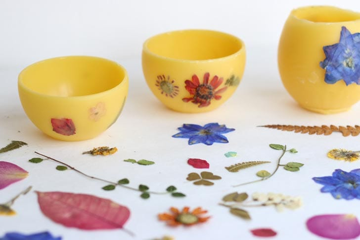 Homemade beewax bowls inlaid with pressed flowers.