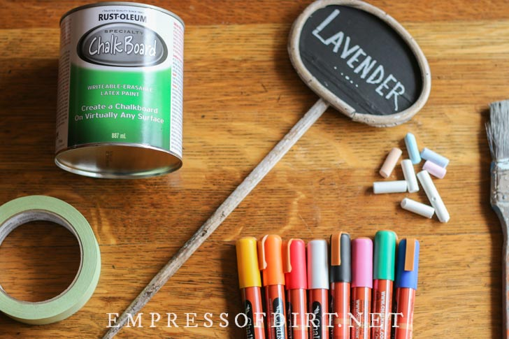 Supplies for painting plant tags with chalkboard paint.