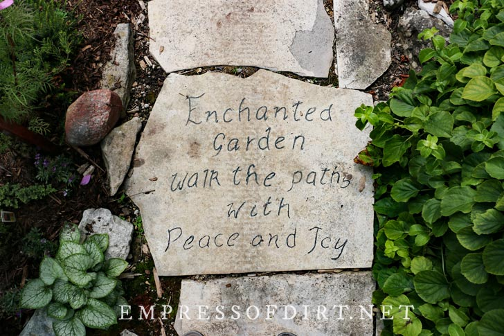 Engraved stepping stones in garden.
