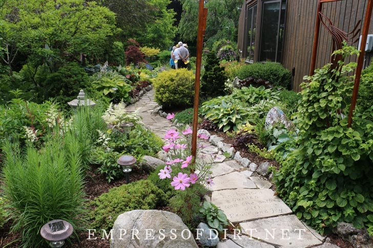 Winding garden path with engraved stones.