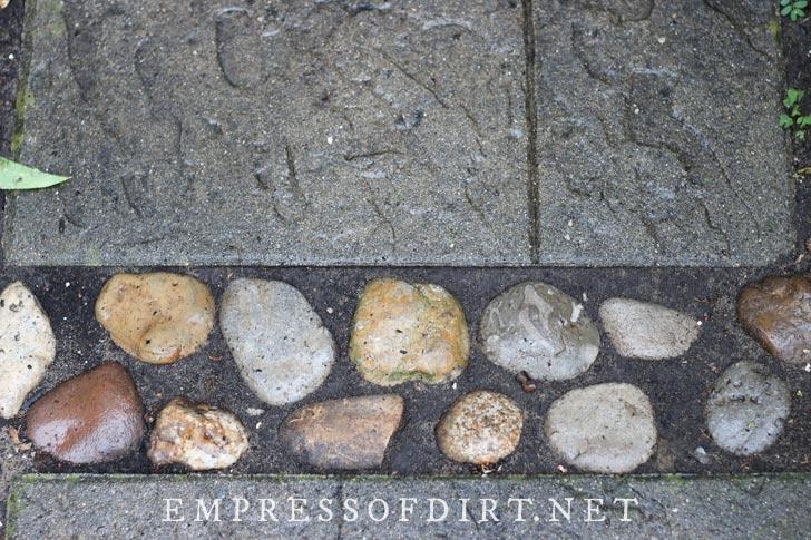 Inlaid stone detail on garden path.