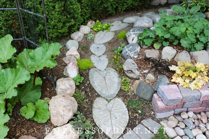 Leaf-shaped stepping stones in garden.