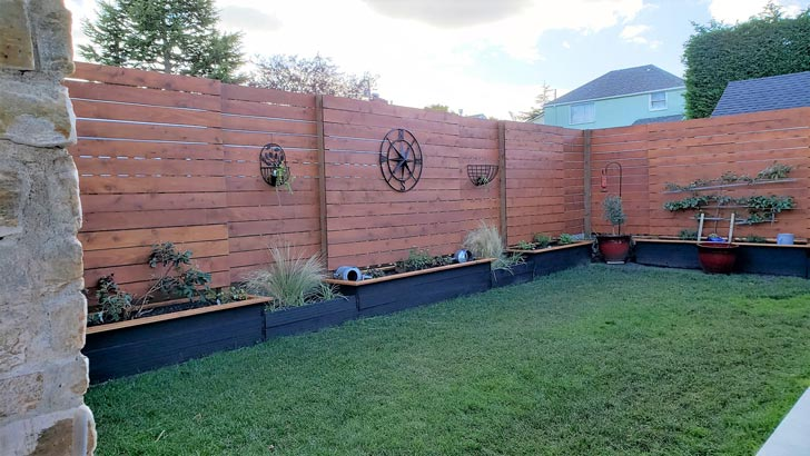 Raised beds with built-in privacy walls.