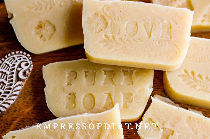 Homemade soap bars with hand-stamped letters.