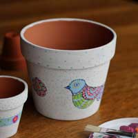 Hand-painted clay flower pot.