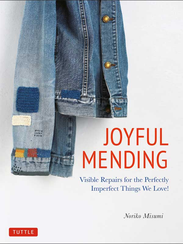 Joyful Mending (book) by Noriko Misumi showing creative repairs to a jean jacket.