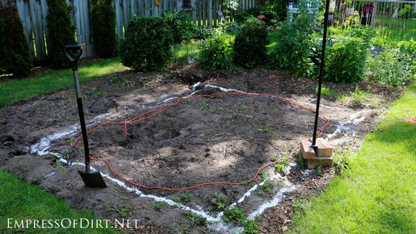 Planning the site for a backyard garden pond.