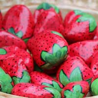 Stones painted to look like strawberries.