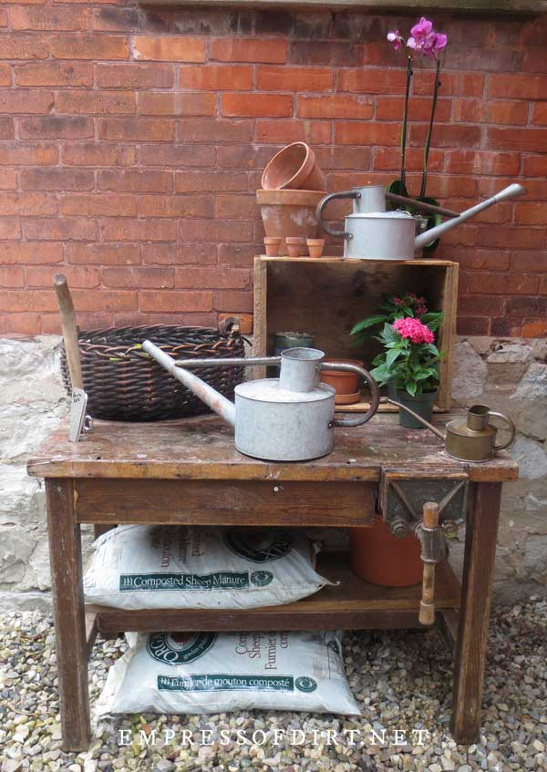 Potting bench with garden supplies.