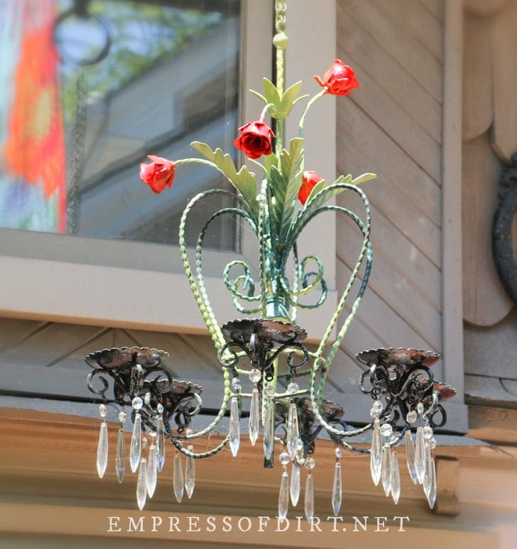 Garden chandelier with painted red roses.