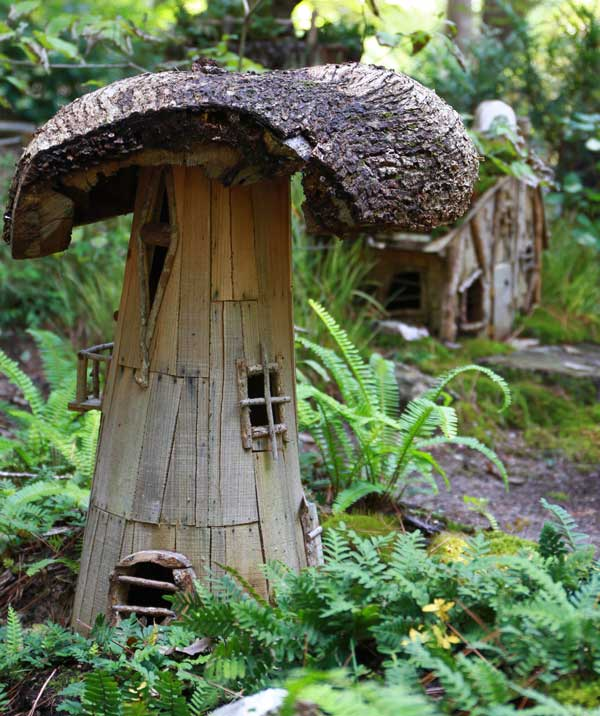 This fairy garden house has a simple door made from twigs.