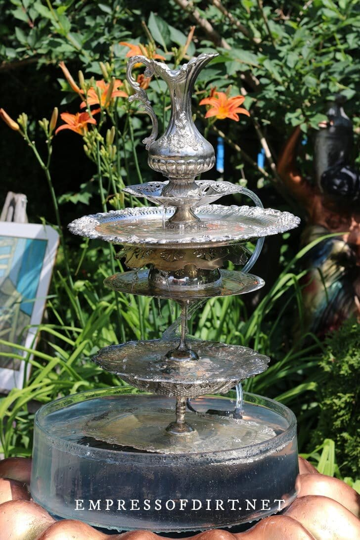 Sterling silver pieces made into a tall garden fountain.