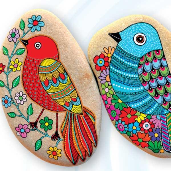 Birds painted on flat stones.