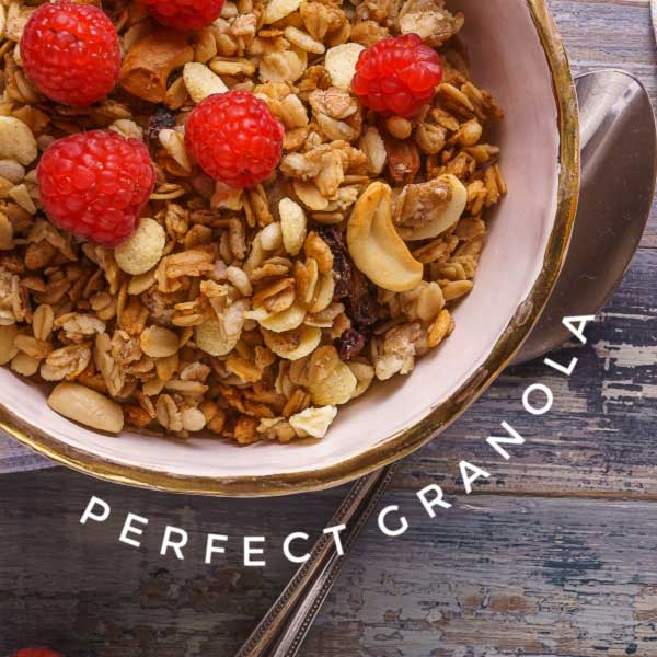Granola in bowl with raspberries.