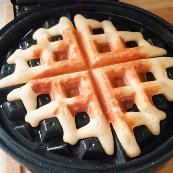 Keto dessert waffle in waffle iron.