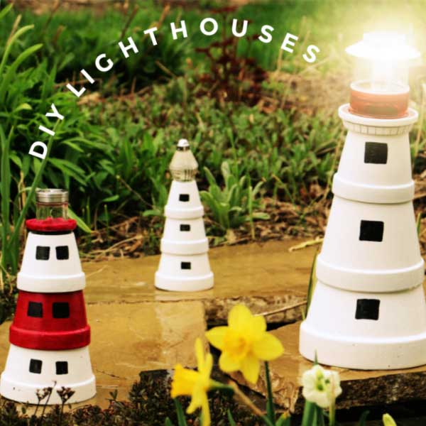 Garden art lighthouses made from clay flower pots.