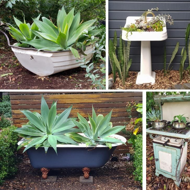 Old bathtub, row boat, sink, and stove used as garden planters.